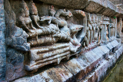One among many - Statue of Lord Vishnu resting on Ananta Sesha.