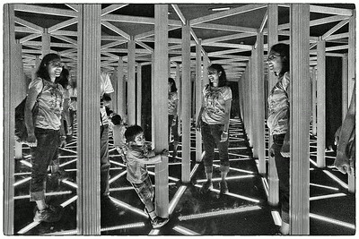 A dark mirror maze at Camera Obscura. Smitha and Vedanth try to find their way out...