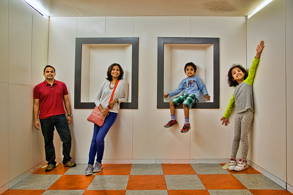 The entire family has the same height... Charan, Harini, Vedanth and Riya have fun in the illusion room