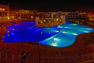 The largest swimming pool in the Crowne Plaza Resort at Dead Sea, Jordan, has 2 bars, and a spa in the middle.